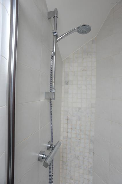 complicated shower cubicle in ensuite in loft conversion